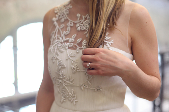 Embroidered white dress, engagement ring