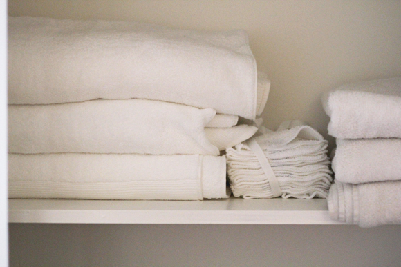 Fresh white towels, linen closet