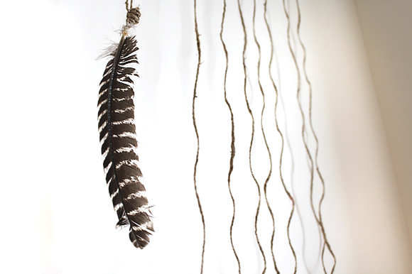 feather-hanging-from-twine