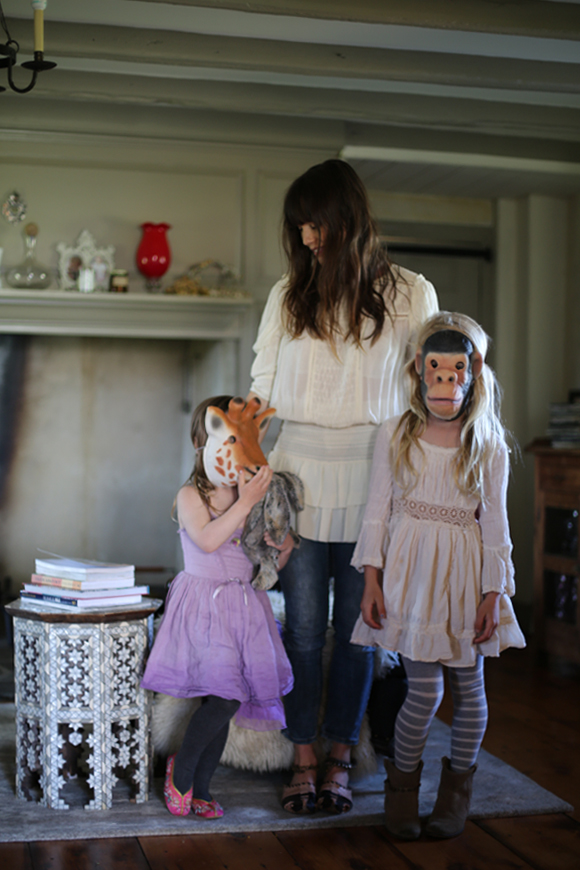 mother with daughters wearing masks