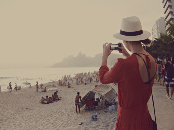 rio brazil beach girl taking photo