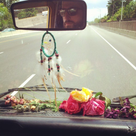 flowers and dreamcatcher in vw bus