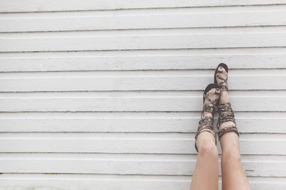 Floral sandals, white wall