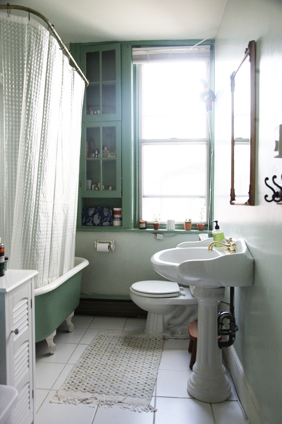 Home tour inside our assistant design manager s eclectic for Green and white bathroom