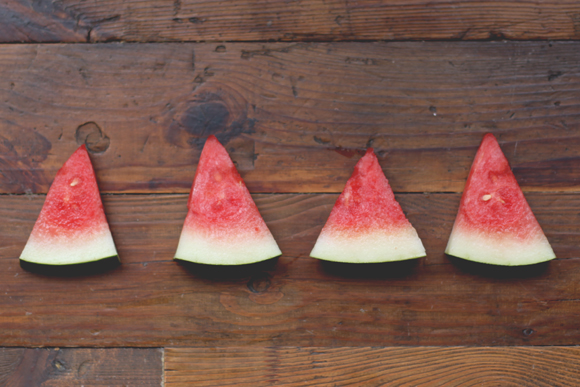 Slices of watermelon on wood
