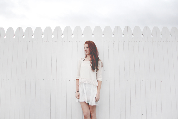 Red hair, white fence