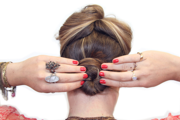 Bun, red nails