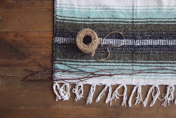 Mexican blanket, twine, twigs