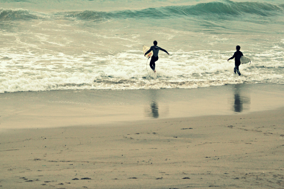 surfers in cornwall