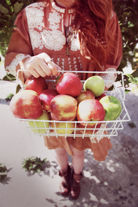 Girl holding apple basket