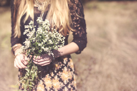 holding flowers in the fall