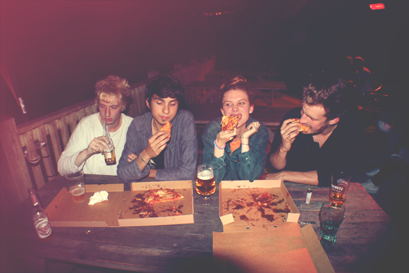 the band eating pizza
