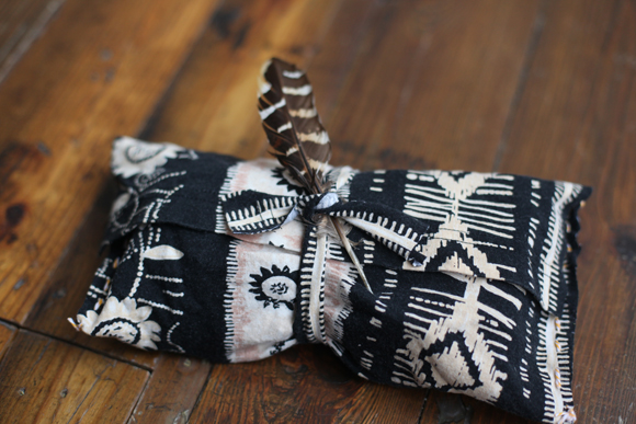 Gift wrapped in old fabric with feather