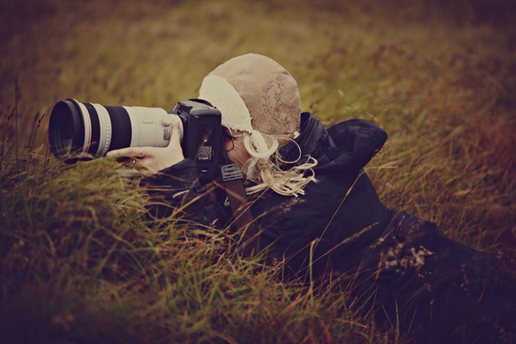 photographer in grass