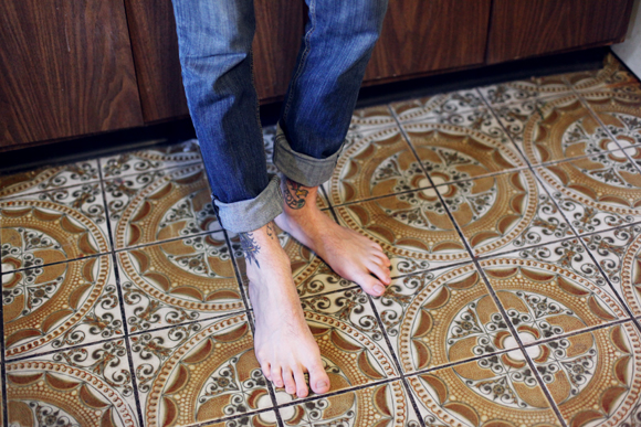 Tattoos, patterned kitchen floor