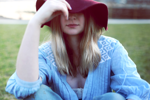 chambray shirt and red hat