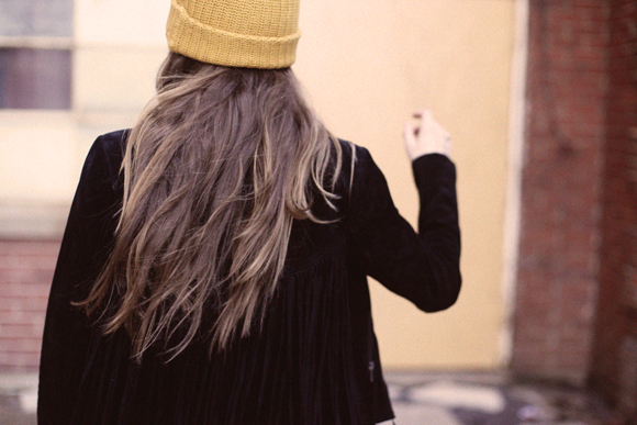 Long hair, mustard beanie, fringe jacket