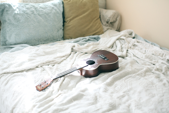 Ukulele on bed
