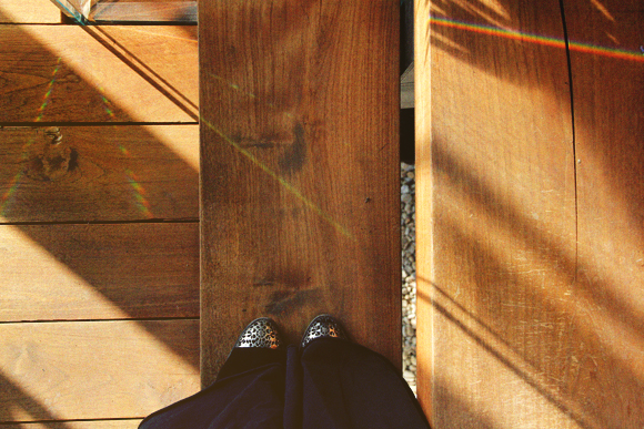 feet on floor with prism