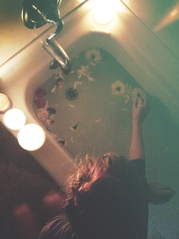 girl putting flowers in tub