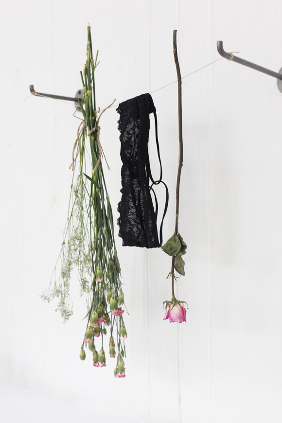 Bra hanging, dried flowers