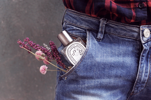 Perfume and flowers in pocket