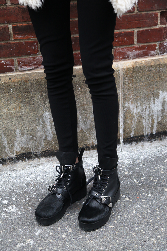 Black pants, black furry boots