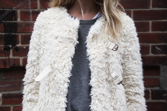 Fur coat with straps