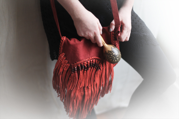 Red fringe bag, maraca