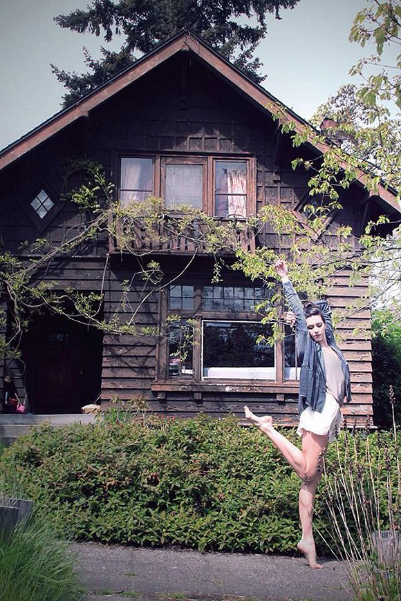 pose in front of house