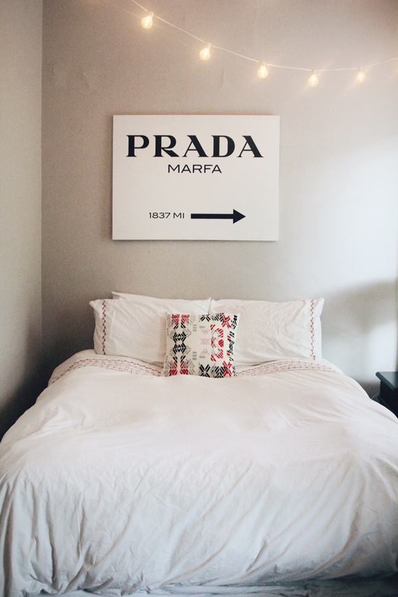 prada sign and bed