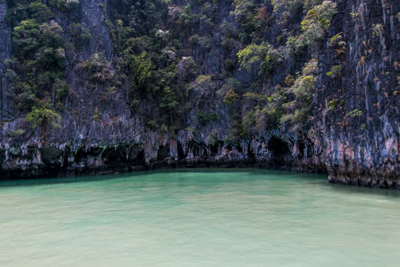 Canoeing around limestone caves
